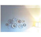 our little collection of 50 cent vintage plates around in a cloud of wall decor above our breakfast nook
